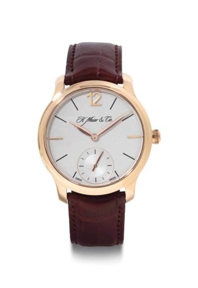 Moser.  An 18k Pink Gold Wrist