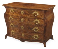 A GERMAN WALNUT AND MARQUETRY COMMODE
