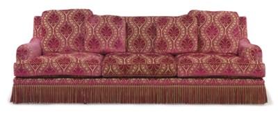 A LARGE THREE SEAT SOFA
