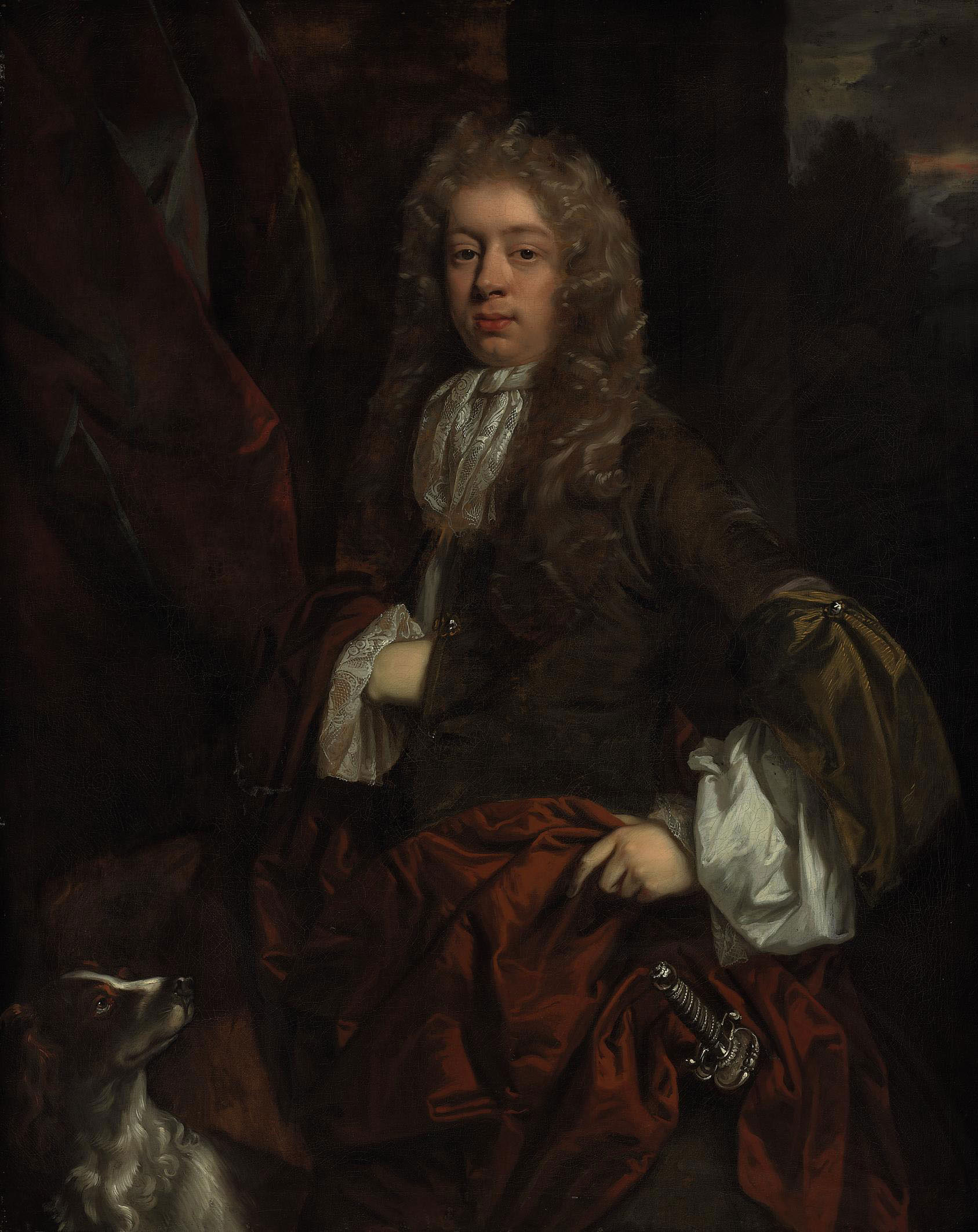 Portrait of a young man, three-quarter-length, with a dog