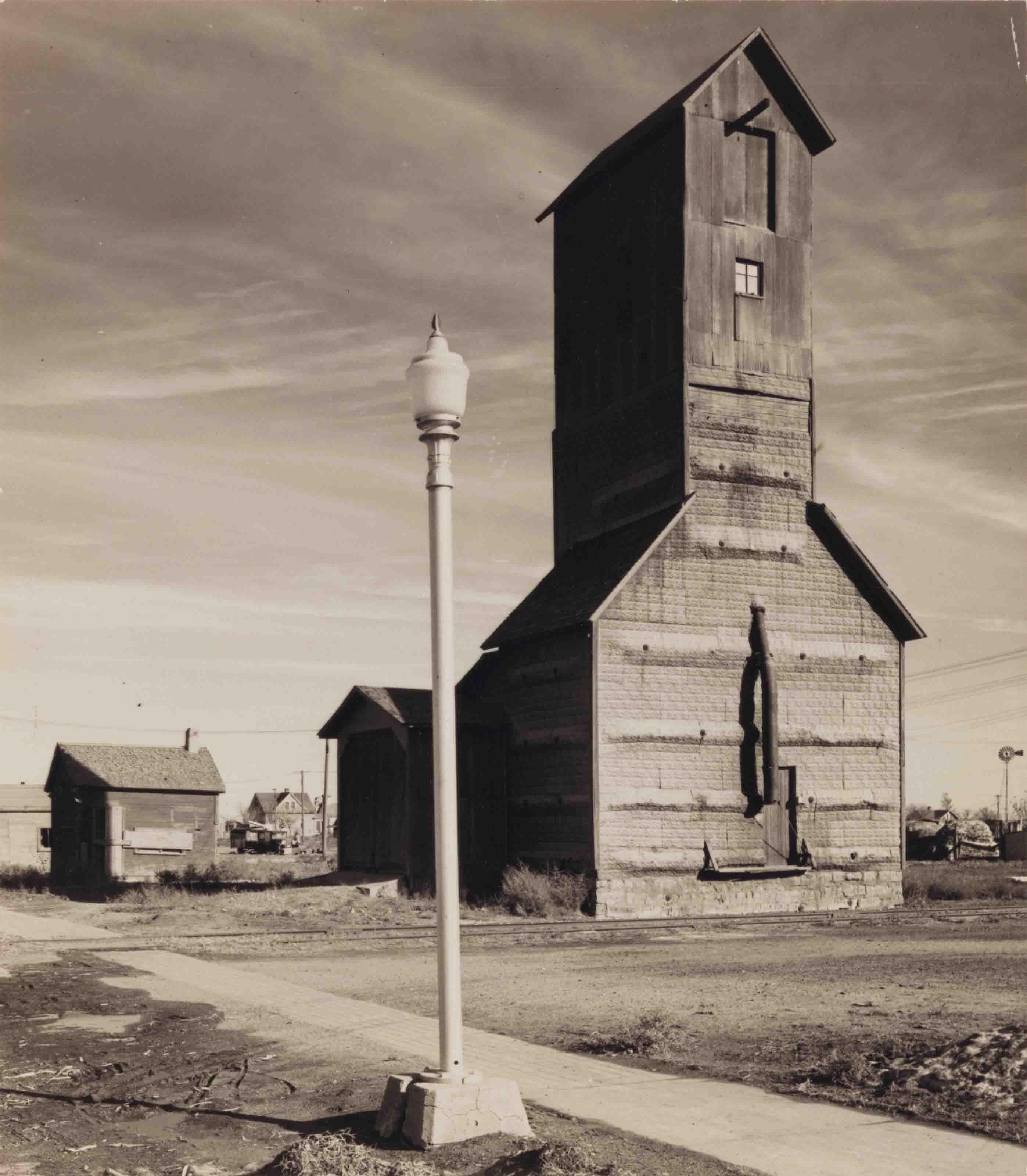 Light Pole and Grain Elevator; and Family Portrait, Season's Greetings, Nebraska, c. 1945
