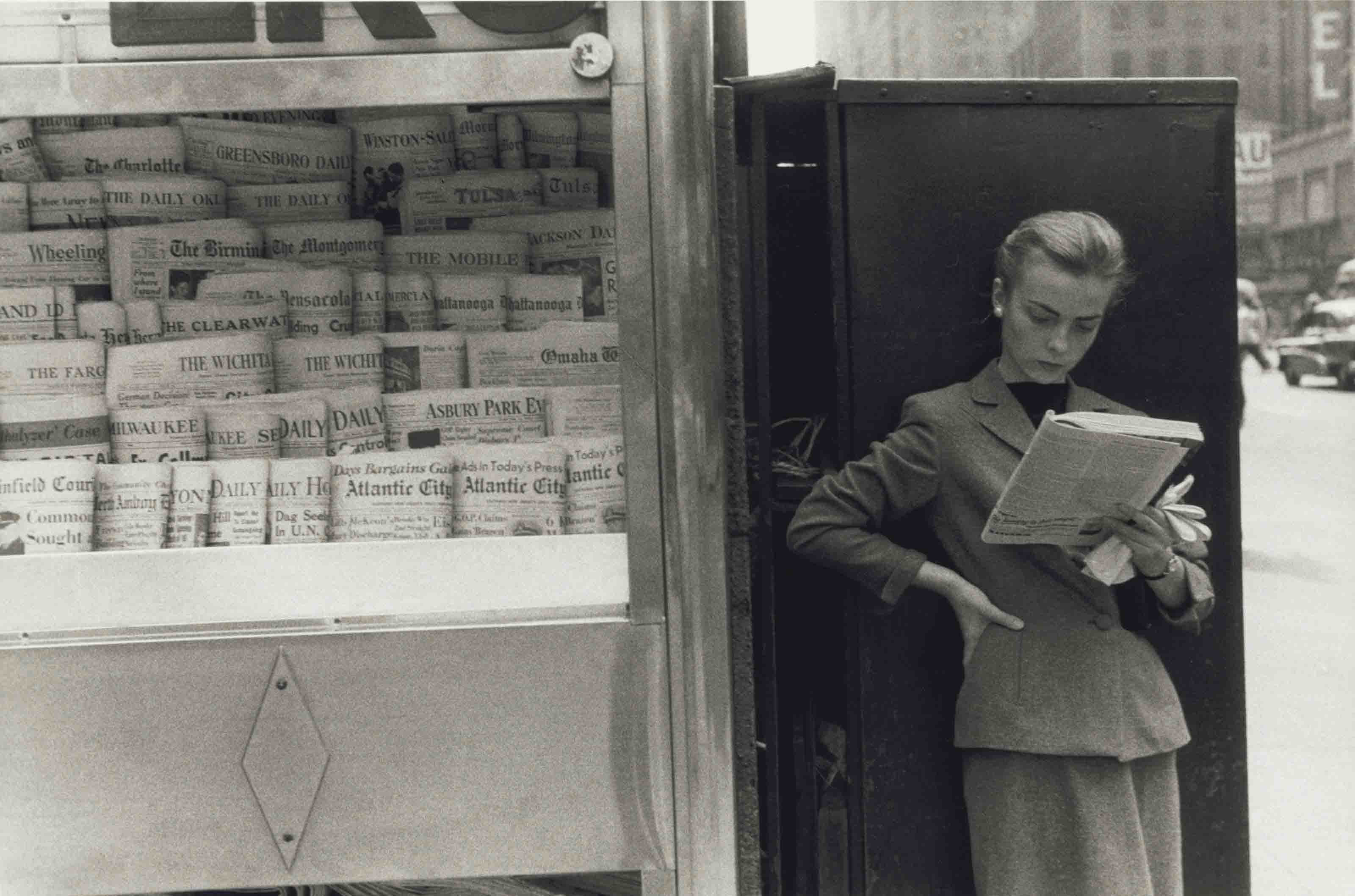 Elbowing an Out-of-Town Newstand, c. 1952