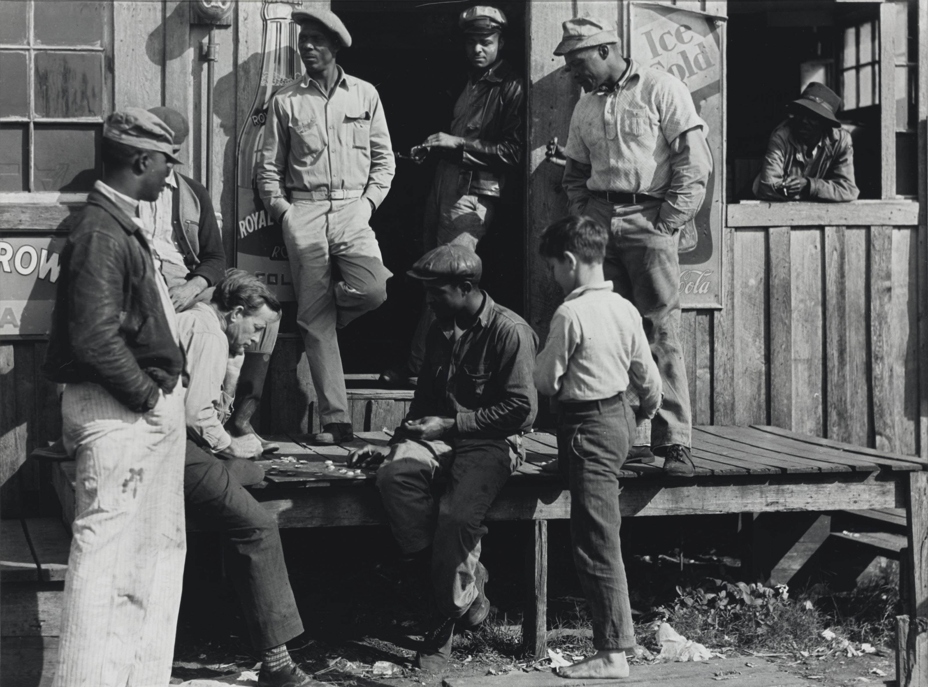Vegetable Pickers Playing Checkers in Front of a 'Jook Joint', Belle Glade, Florida, February 1941