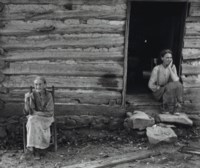 Mother and Daughter in Front of Log Cabin near Carboro, NC, 1939