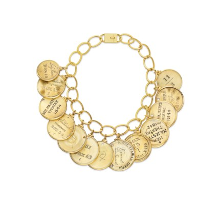 ~AN IVORY AND GOLD NECKLACE