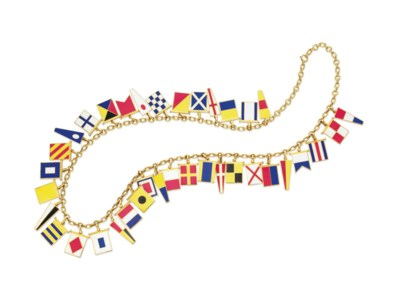 AN ENAMEL AND GOLD FLAG NECKLA