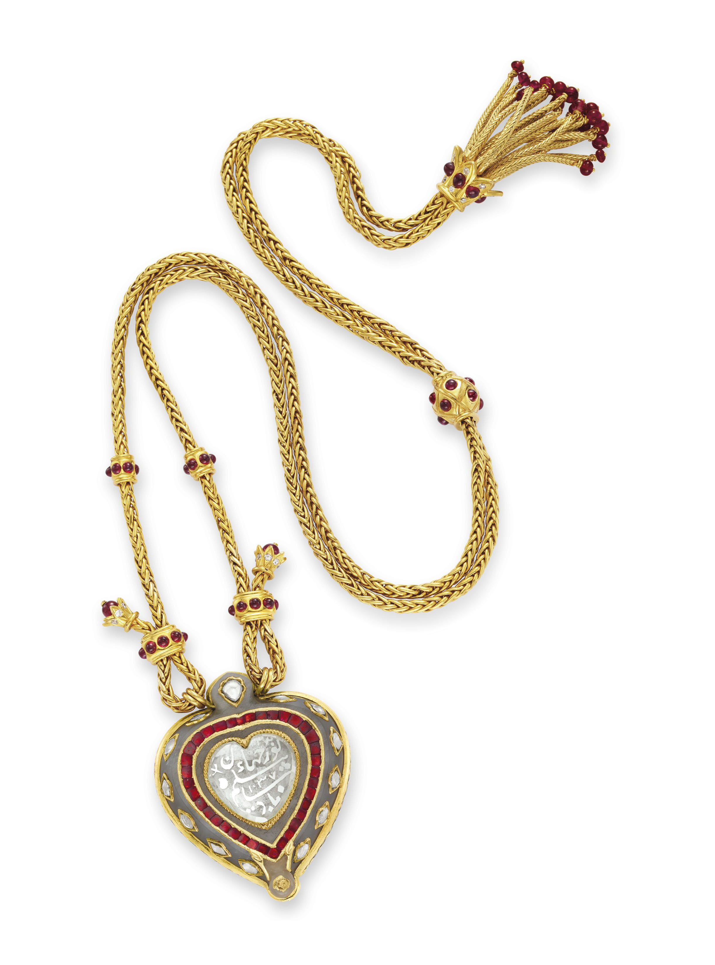 AN INDIAN DIAMOND AND JADE PENDANT NECKLACE RUBY AND GOLD CHAIN, BY CARTIER