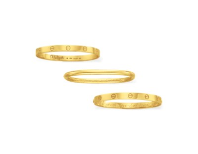 A GROUP OF THREE GOLD BANGLE B