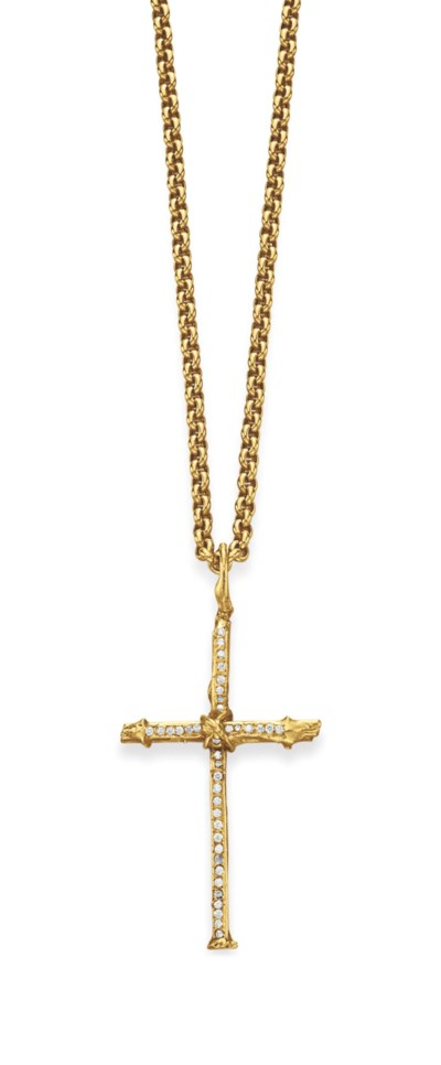 A DIAMOND AND GOLD CROSS PENDA