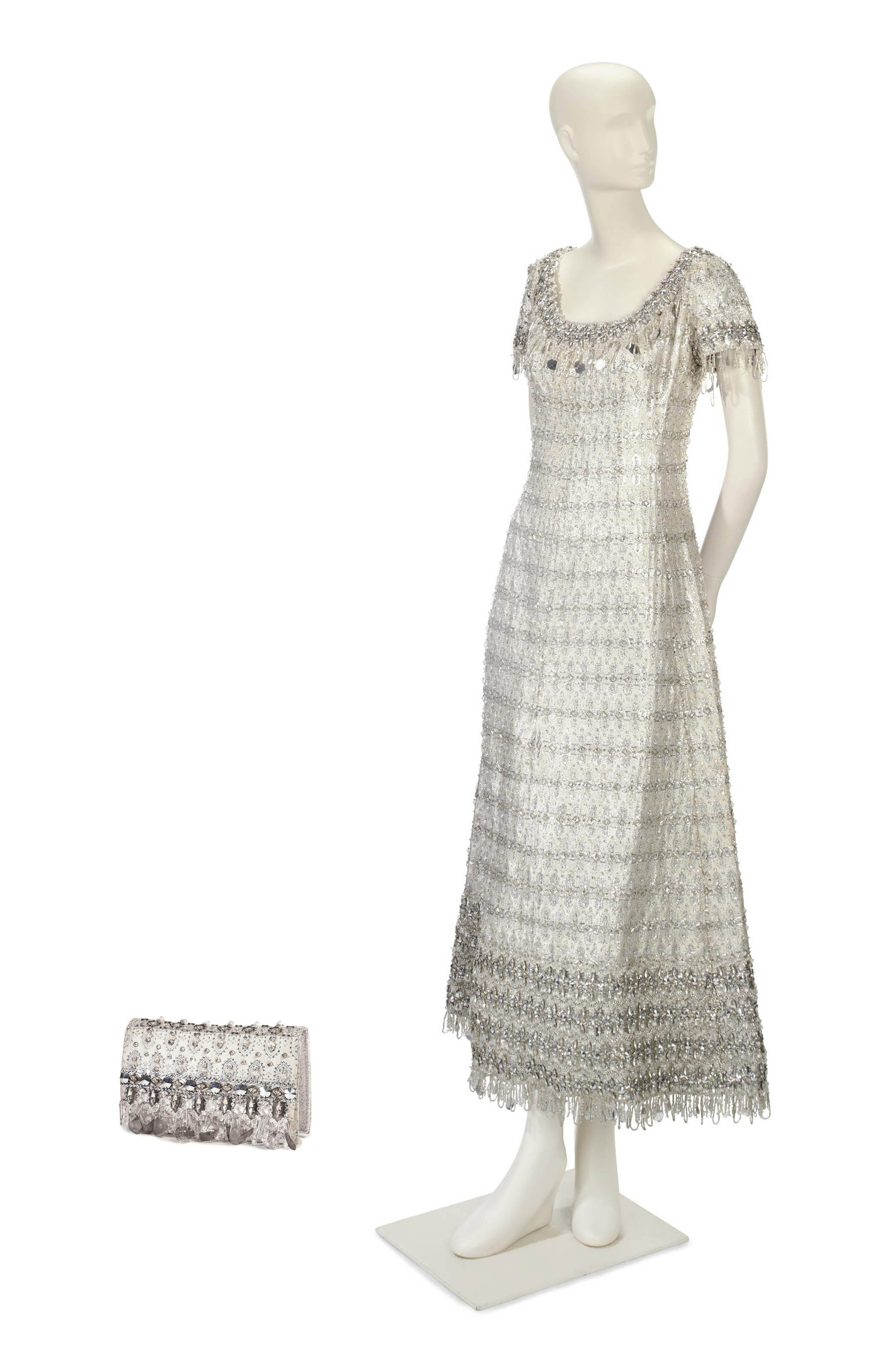 A CHRISTIAN DIOR EVENING GOWN OF SILVER ENCRUSTED BROCADE WITH MATCHING EVENING BAG