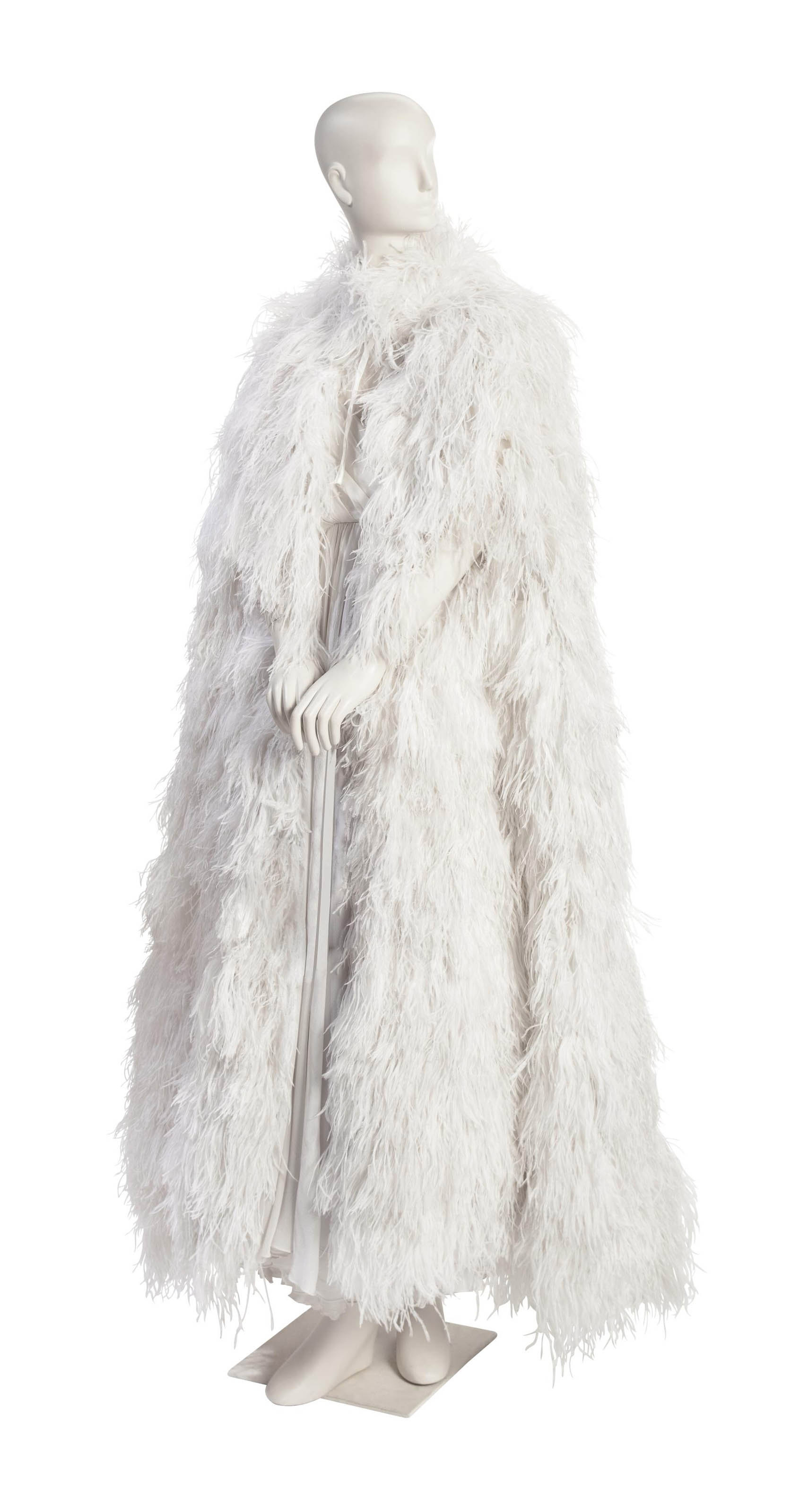 A WHITE FEATHER EVENING CAPE
