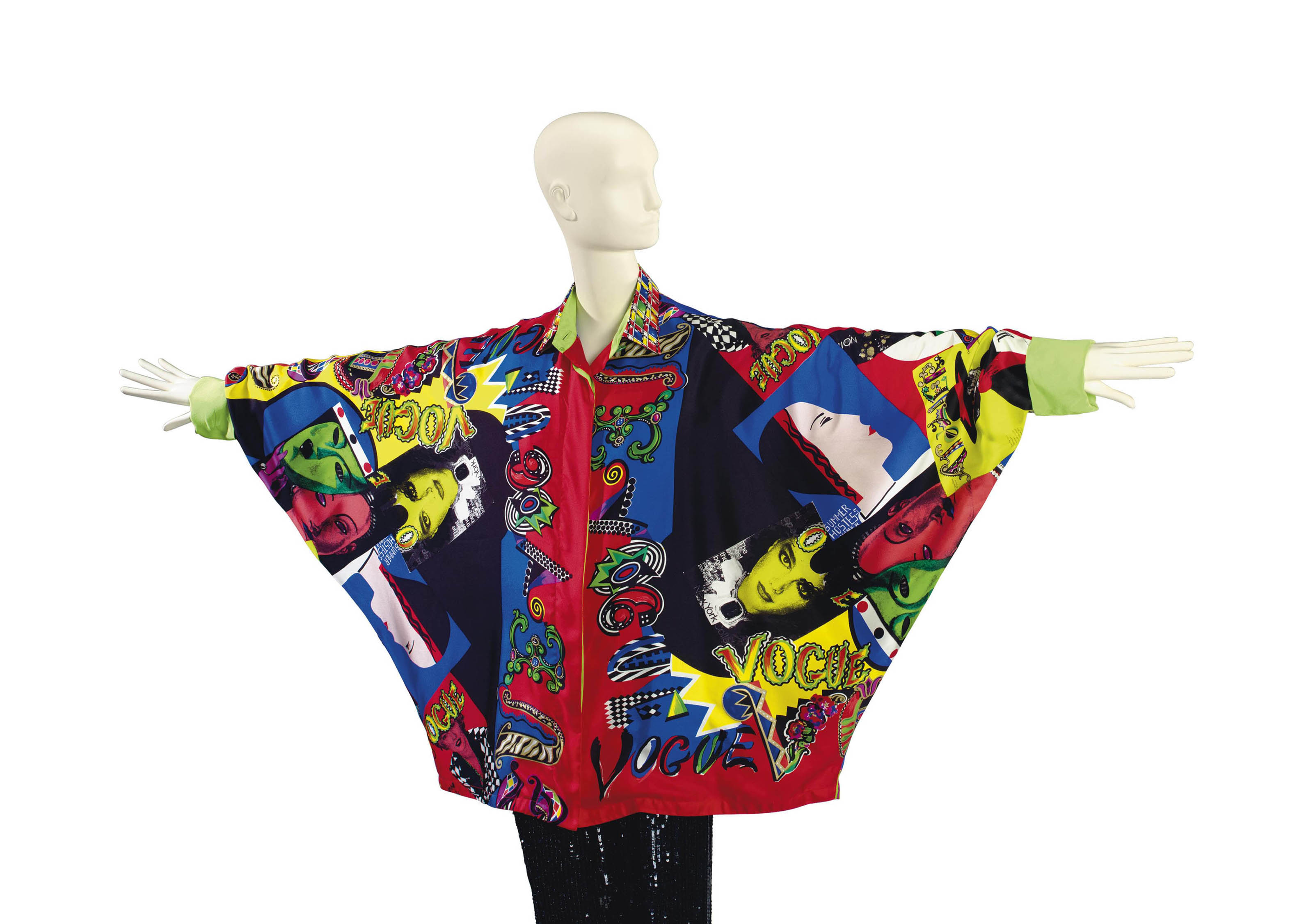 A VERSACE 'VOGUE MAGAZINE' PRINT VOLUMINOUS SILK BLOUSE