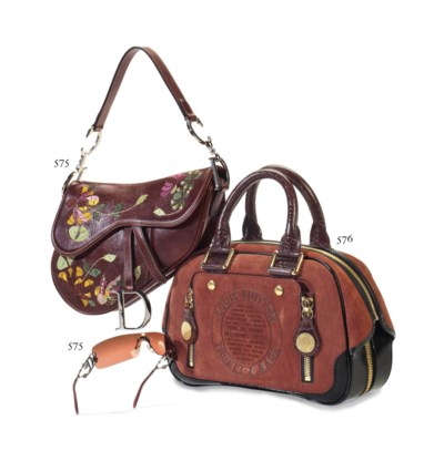A BROWN LEATHER SADDLE BAG AND
