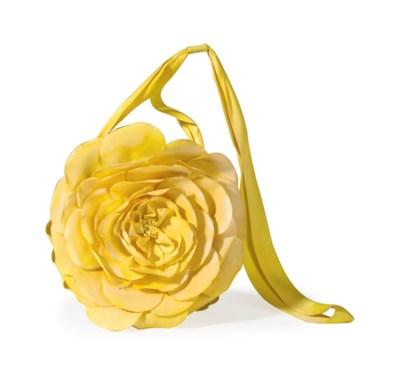 A YELLOW SILK FLOWER BAG