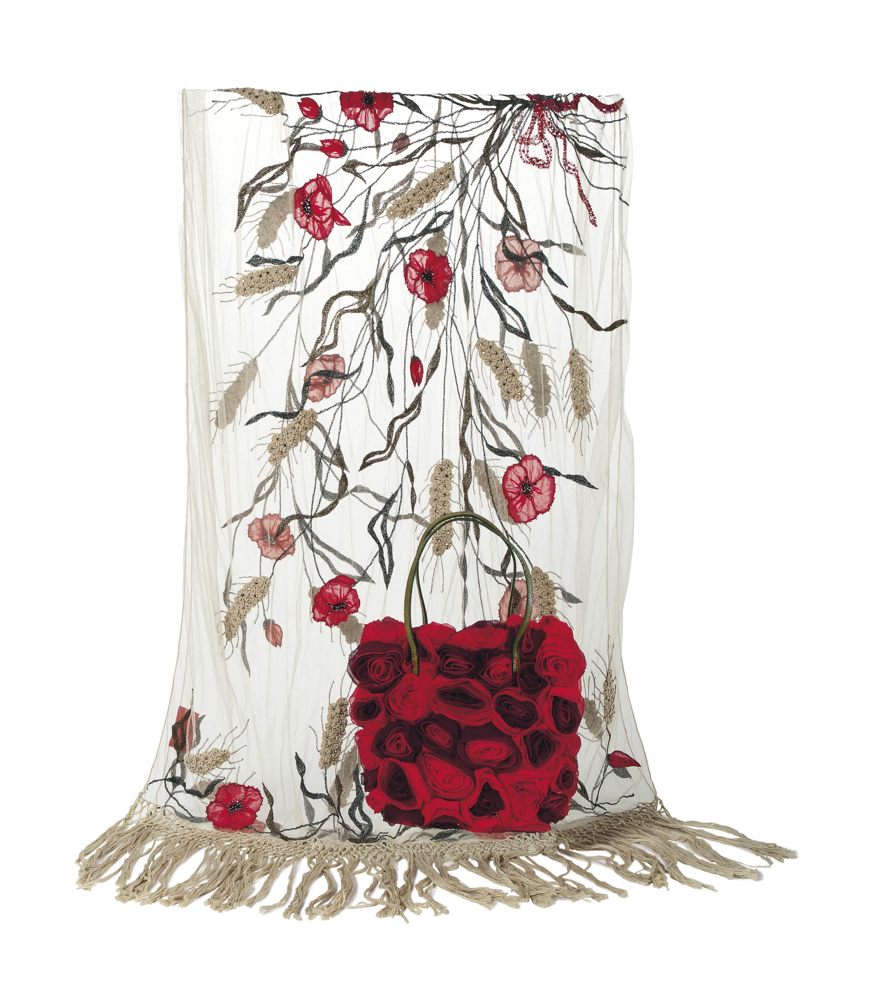 A BAG COMPOSED OF RED CHIFFON ROSES AND AN EMBROIDERED STOLE
