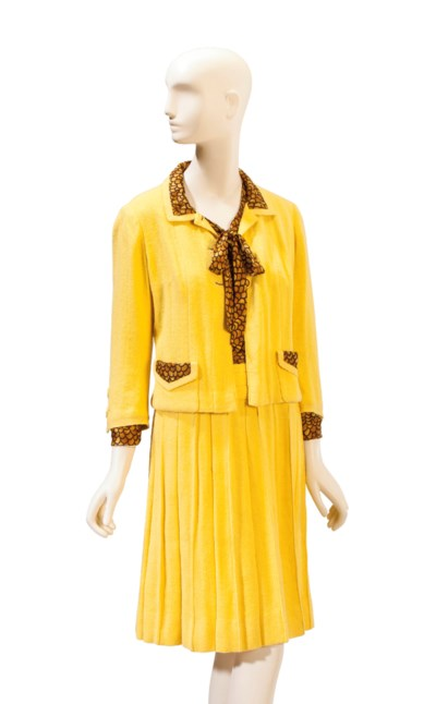 A YELLOW WOOL AND BROWN PRINTE