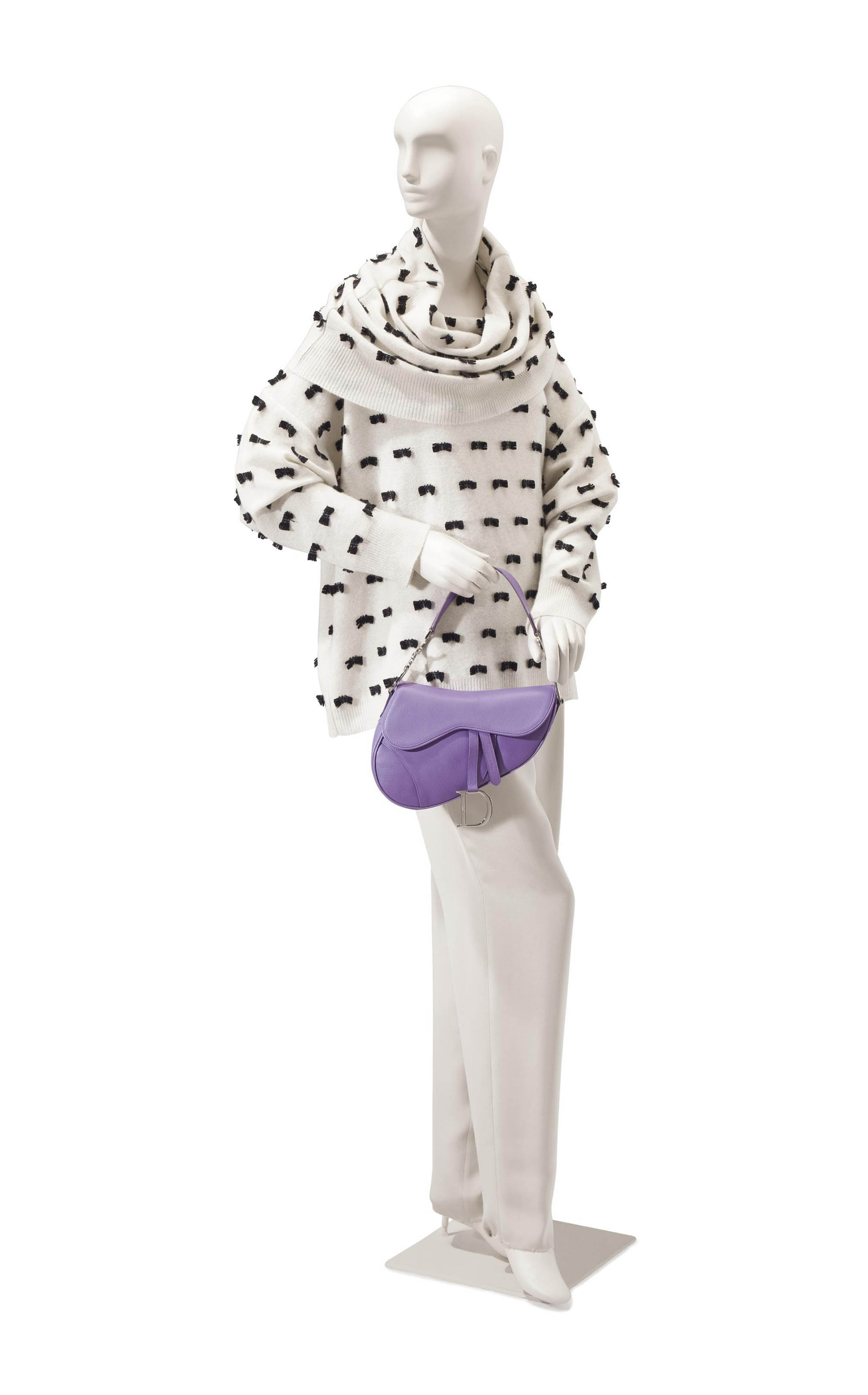 A GALLIANO WHITE CASHMERE SWEATER TRIMMED WITH BLACK BOWS AND A CHRISTIAN DIOR SADDLE BAG