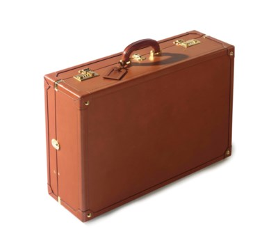 A TAN LEATHER HARD-SIDED SUITC