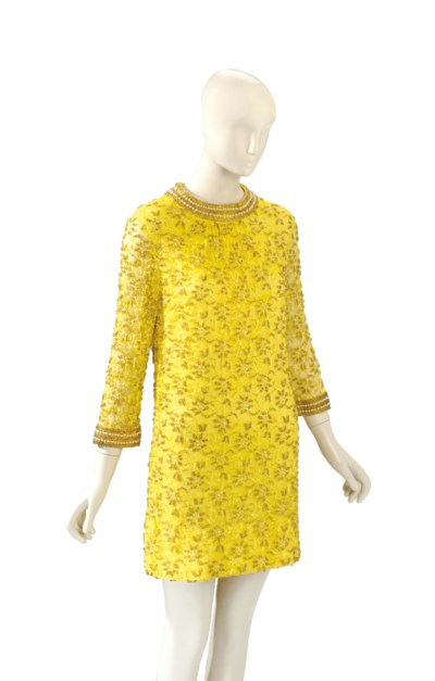 A YELLOW BEADED AND LACE MINID