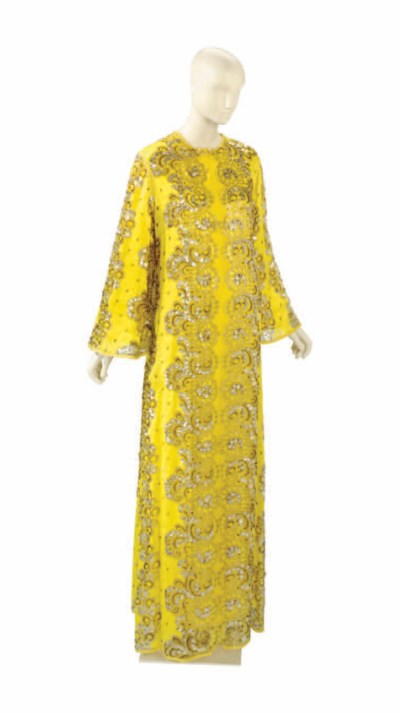 A YELLOW SILK AND EMBROIDERED