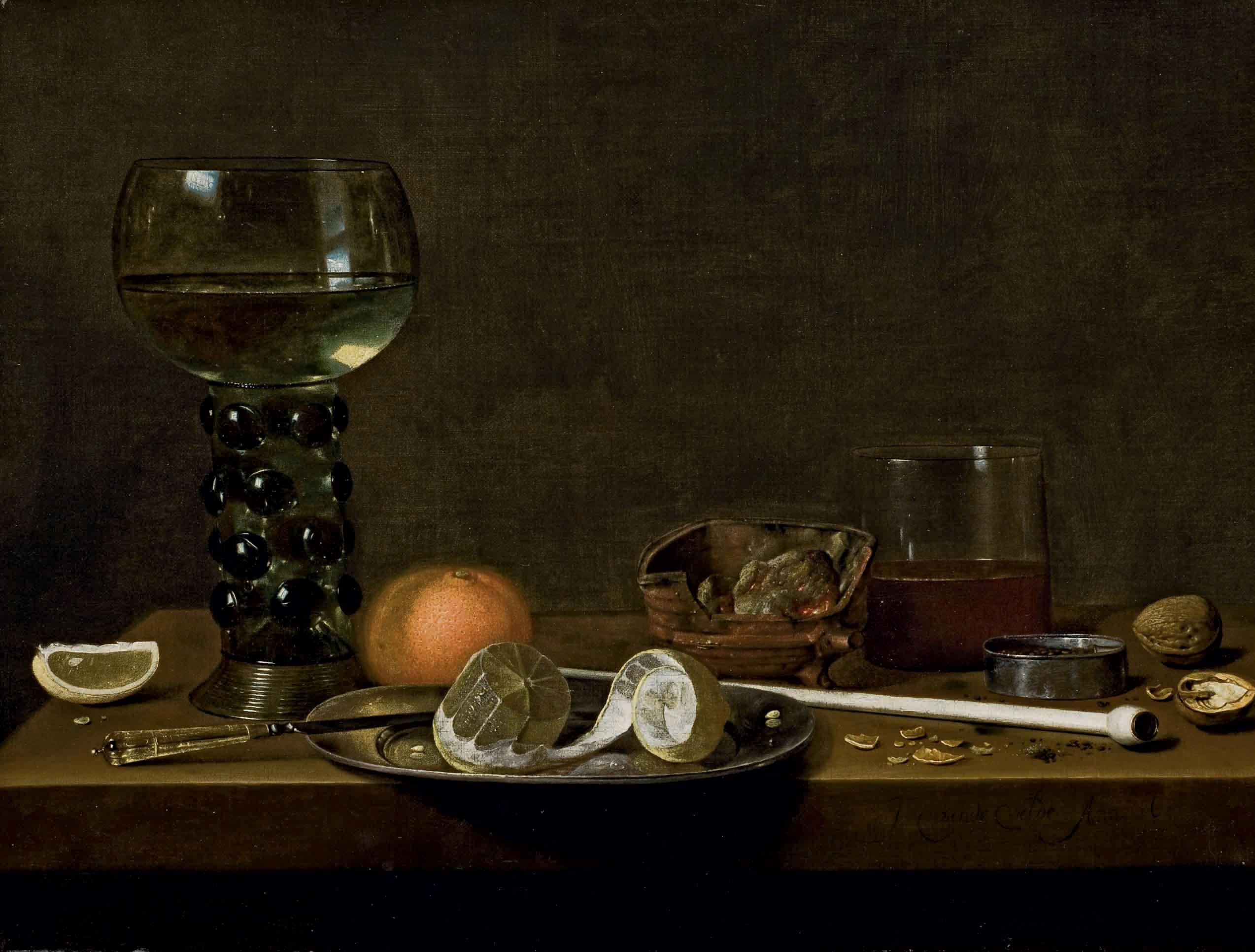 Roemer, citron pelé, orange et divers objets posés sur une table