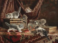 Kittens with books and a fish bowl