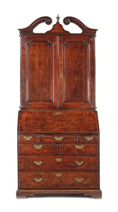 A George I oak bureau cabinet