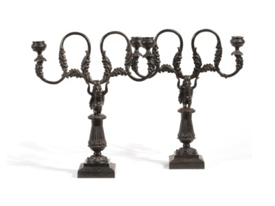 A PAIR OF GERMAN CAST-IRON FIGURAL TWO-LIGHT CANDLESTICKS