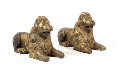 A pair of gilt-bronze chenet s
