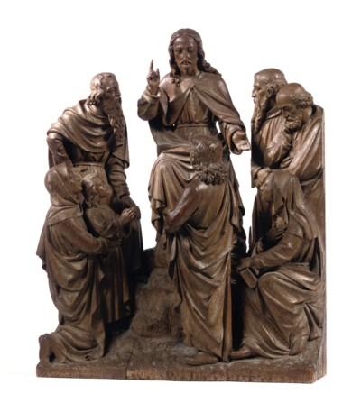 A CARVED OAK GROUP OF CHRIST B