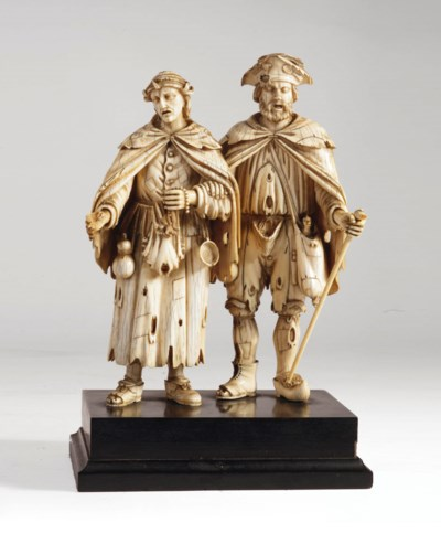 A carved ivory group of two be