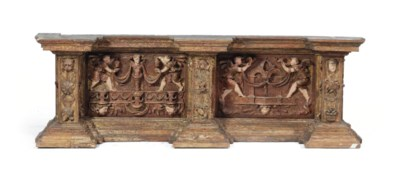 A PARCEL-GILT CARVED PINE ARCH