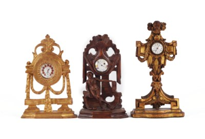 THREE CARVED WOOD WATCH STANDS