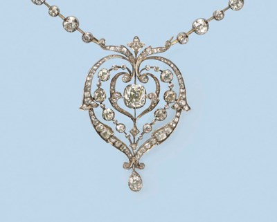 AN ANTIQUE DIAMOND NECKLACE BY
