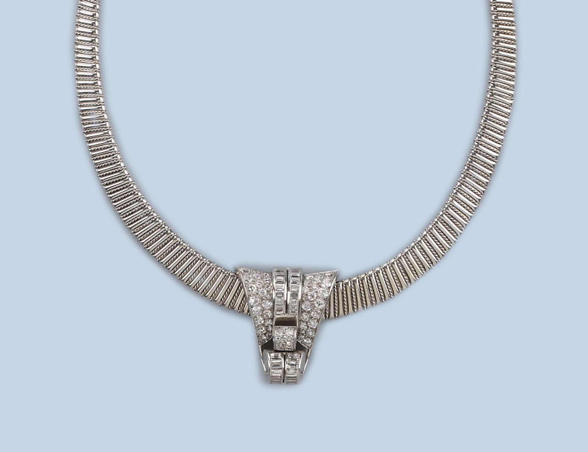 A PLATINUM AND DIAMOND CLIP, BY MELLERIO