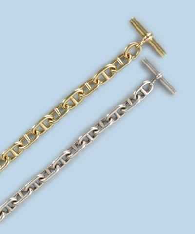 A GOLD AND A SILVER BRACELET