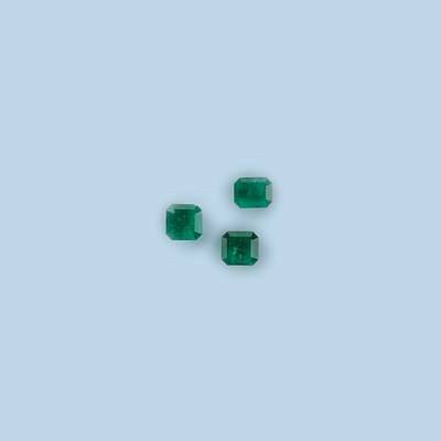 FIVE UNMOUNTED EMERALDS