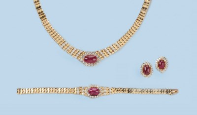 AN 18K GOLD RUBY AND DIAMOND P