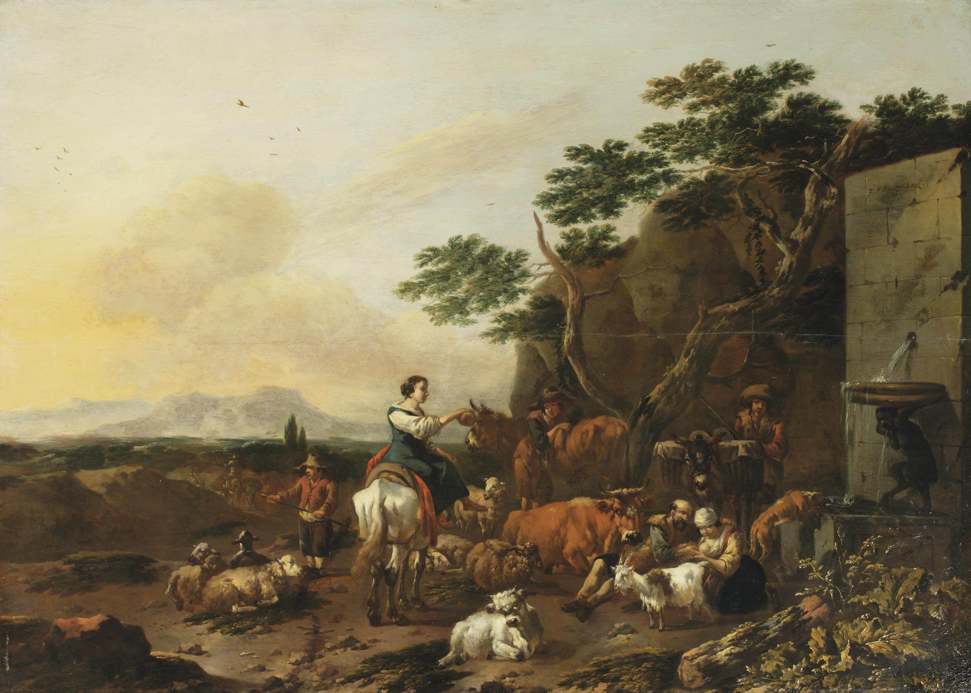 An Italianate landscape with shepherds and their stock resting near a fountain