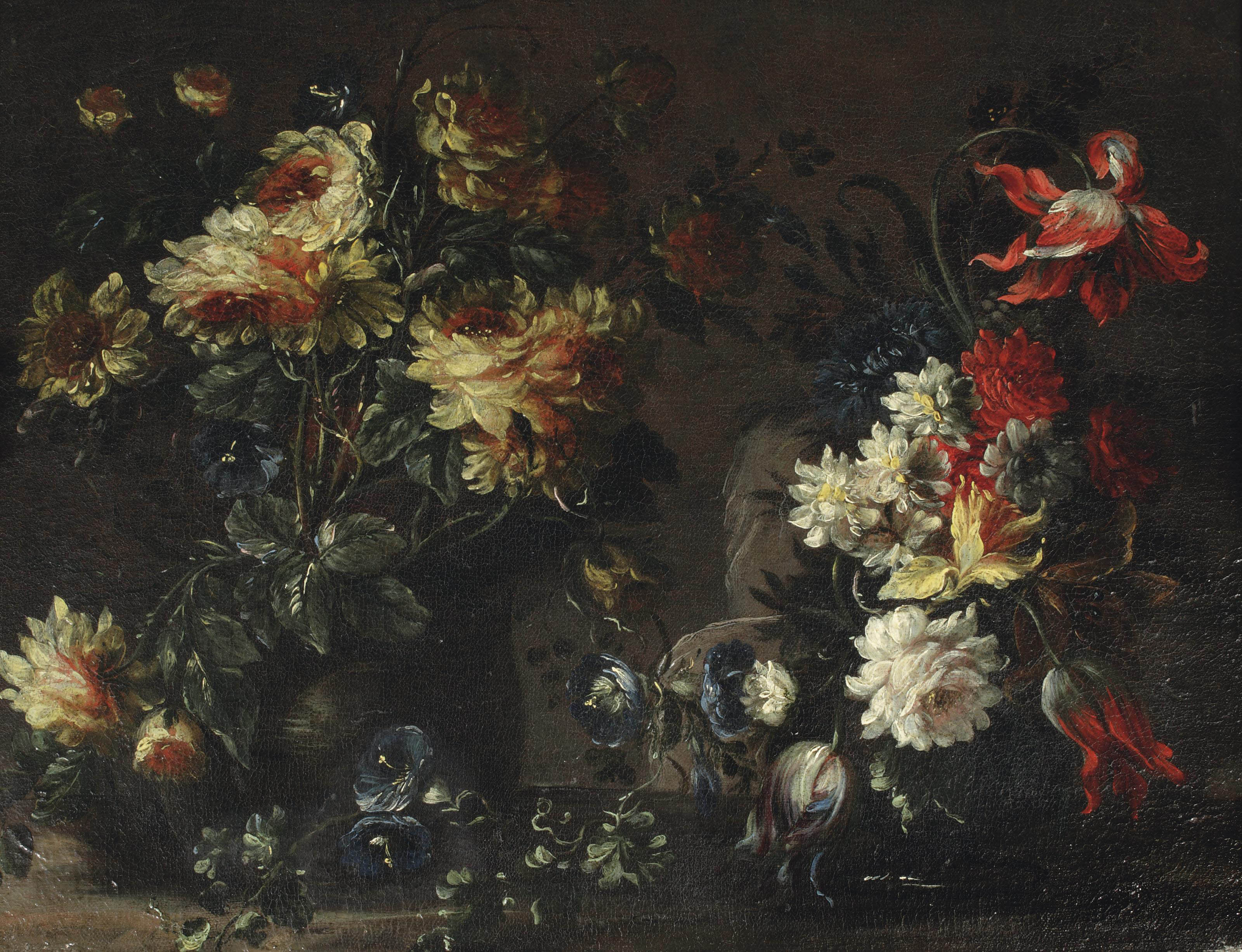 Tulips, roses and other flowers in two vases on a ledge
