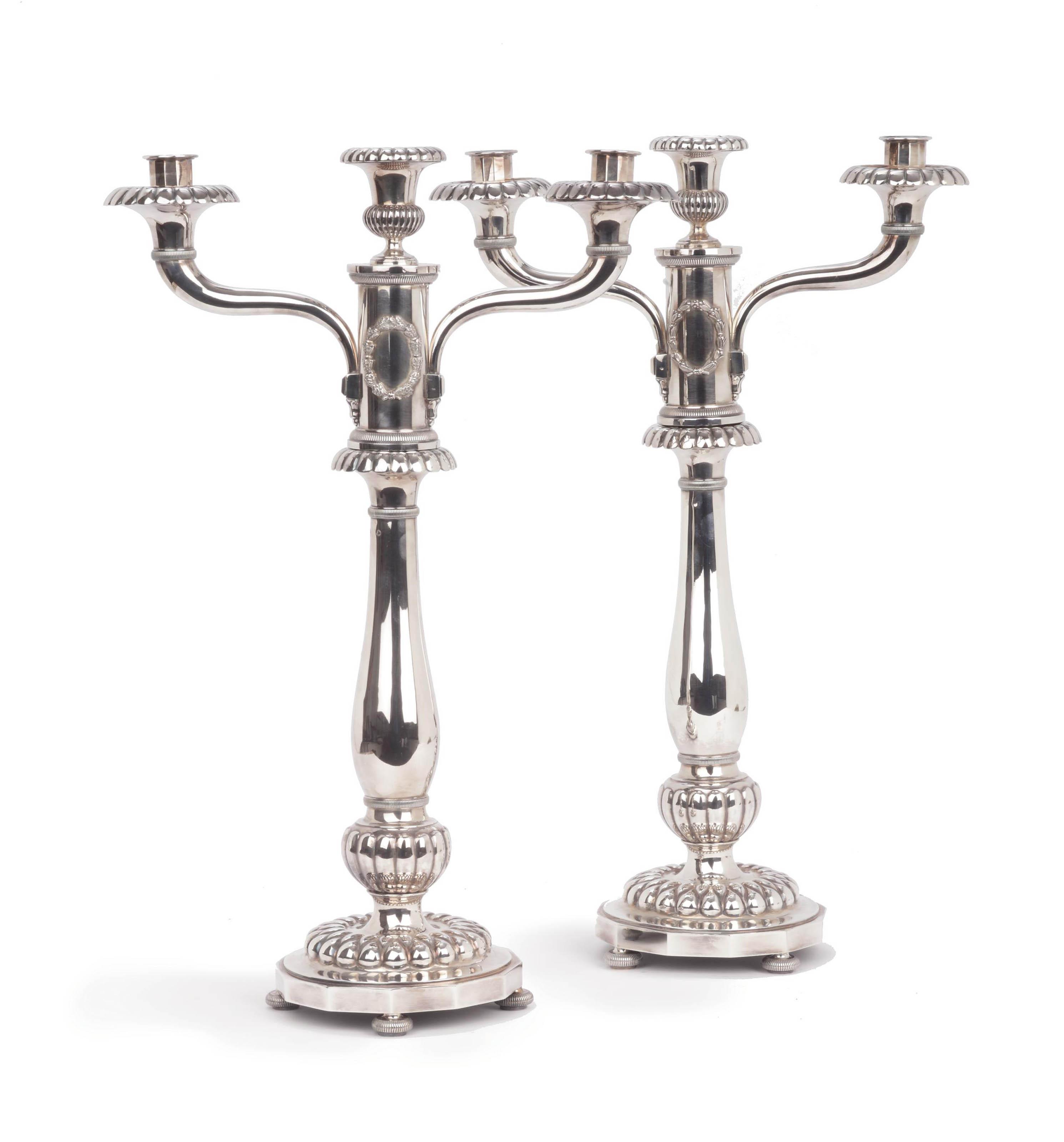 A pair of Dutch silver three-light candelabra