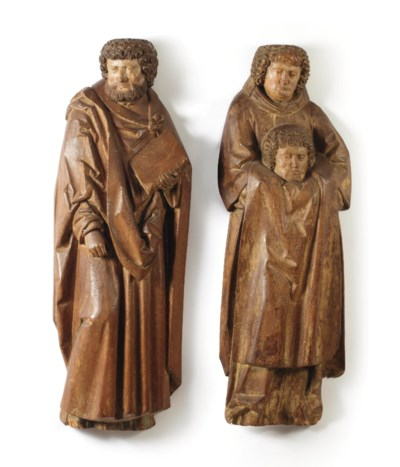 A pair of carved limewood high