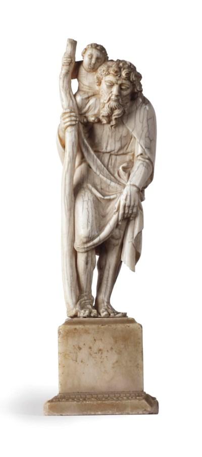 A carved ivory figure of Saint