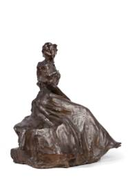 A bronze figure of a seated la