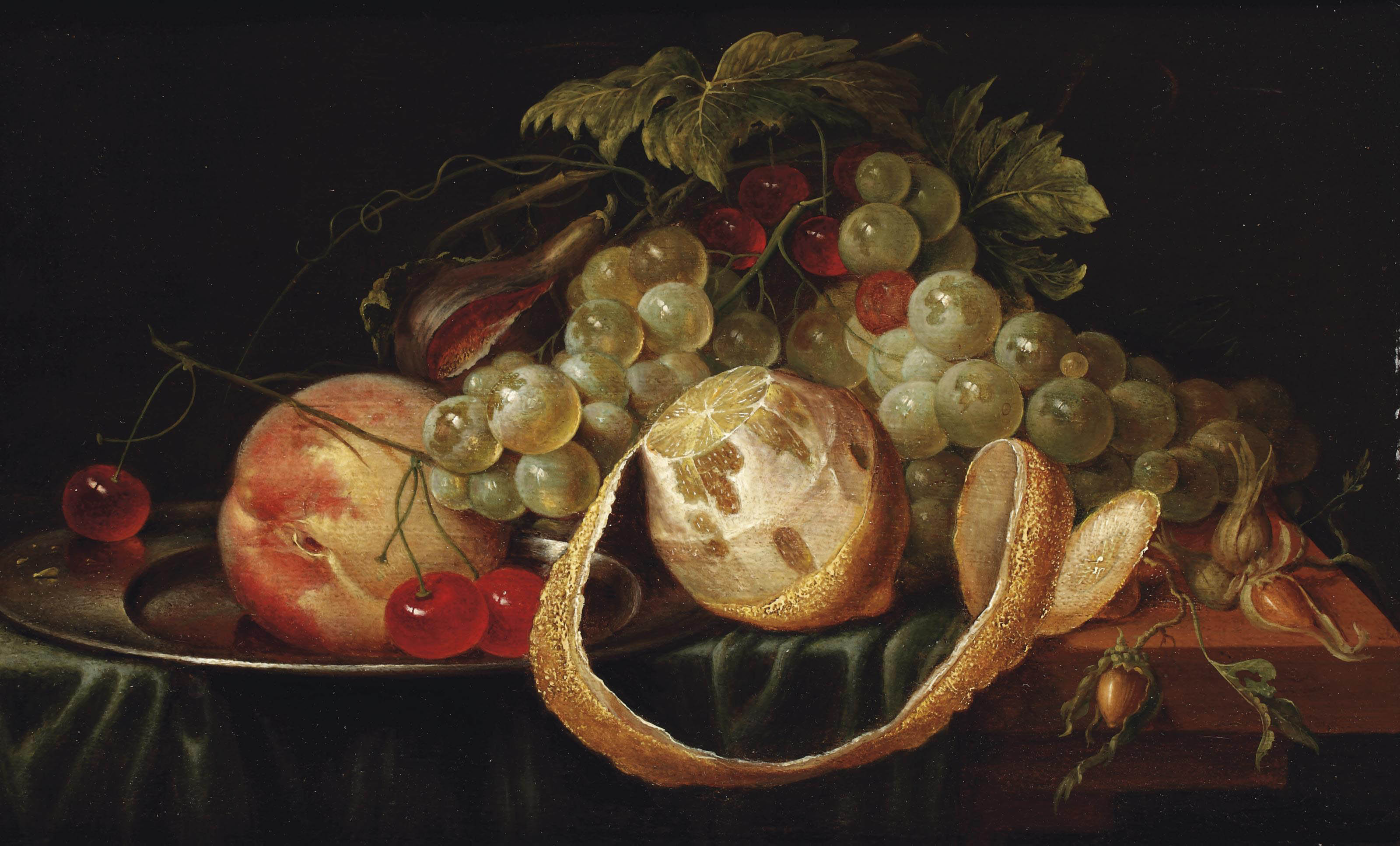 A lemon, white grapes, a peach and cherries on a pewter plate, a fig and hazelnuts, all on a partially draped stone ledge