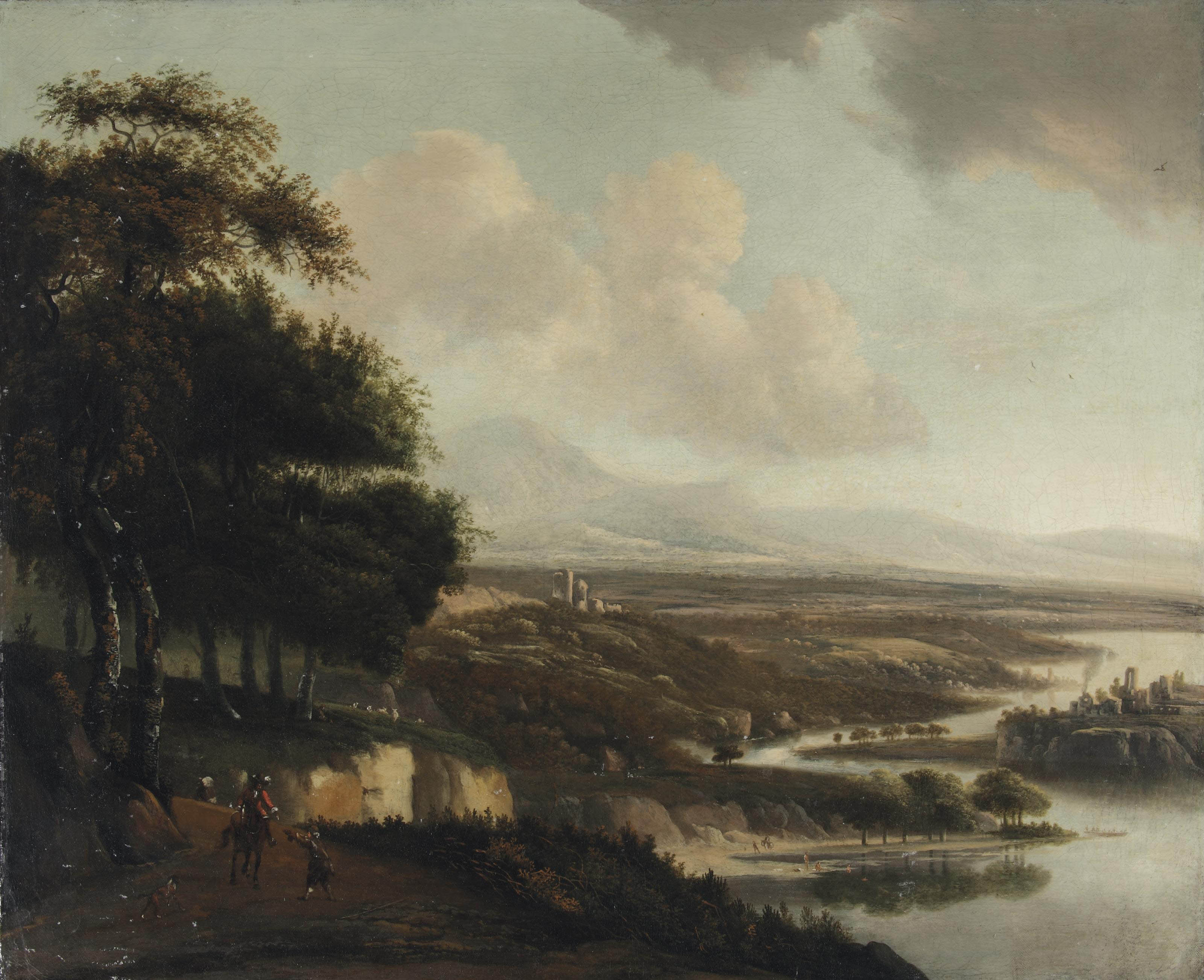 An extensive Italianate river landscape with horsemen on a path