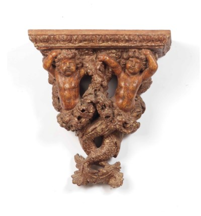 A GERMAN FIGURAL CARVED GILTWO