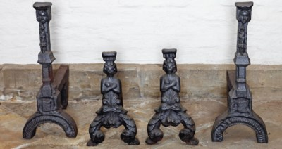 A pair of cast iron firedogs