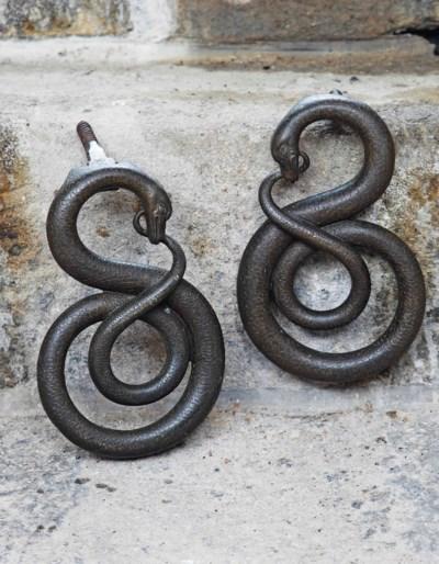 A pair of Italian bronze door-