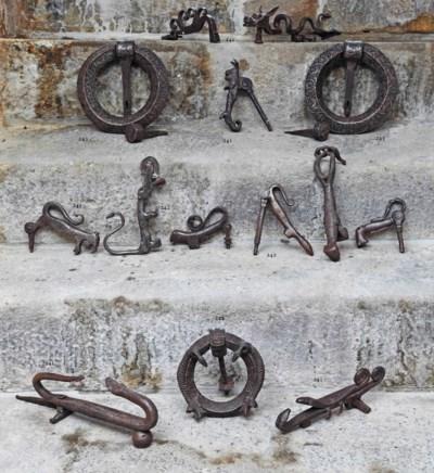 Three wrought iron door-knocke